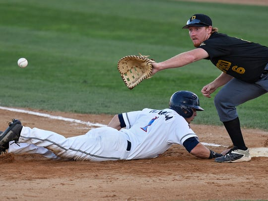 Mason Mamarella of the Rox dives back to first to beat a tag by Rockford's Hunter Hargrove during Thursday's game at Joe Faber Field in St. Cloud.