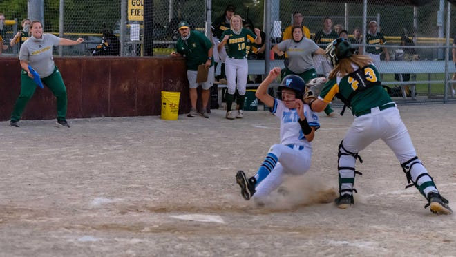 Rock Bridge catcher Abby Hay (23) tags out Tolton courtesy runner Margot Mills (11) in the ninth inning of a game Wednesday at American Legion Park.