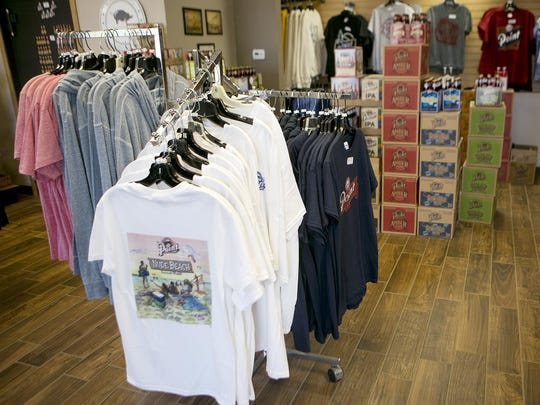T-shirts and Point Brewery beer are on display at the remodeled gift shop at Point Brewery, Thursday, June 25, 2015.