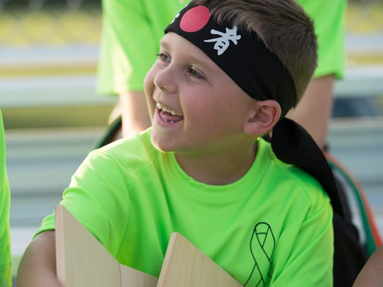 Second-grader Von Kleiv, 7, with his broken boards that he broke during a karate demonstration at Laps For Lymphoma fundraiser at Major George S. Welch Elementary School on Dover Air Force Base. Von was diagnosed with lymphoma in 2016.