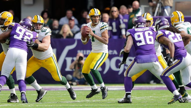Green Bay Packers quarterback Brett Hundley (7) looks to pass against the Minnesota Vikings in the third quarter during their football game Sunday, October 15, 2017, at U.S. Bank Stadium in Minneapolis, Minn.