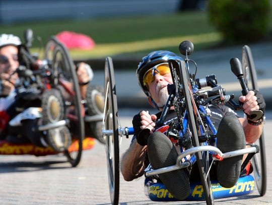 Racers make their way along the course during the Handcycles