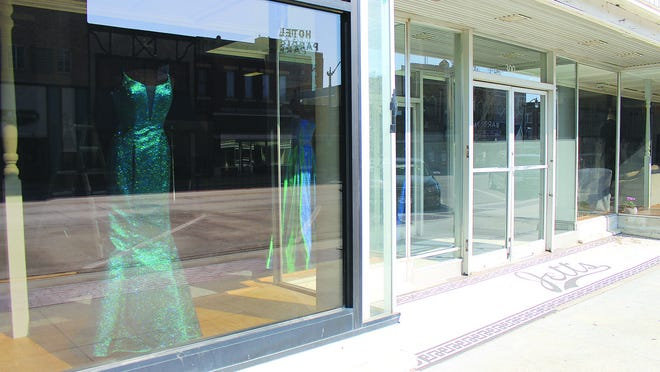 Colorful formal dress options have been appearing in the windows of Pratt's former Jetts and Sears store on South Main Street, which will soon open as Small Town Curves, when coronavirus restrictions are lifted.