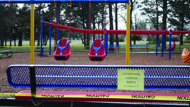 Yellow caution tape around the inclusive playground at Pratt's Sixth Street Park is up to keep children of all ages from congregating at that area, due to coronavirus spread concerns. City officials made the move to close play areas in all city parks at their meeting Monday via Zoom.