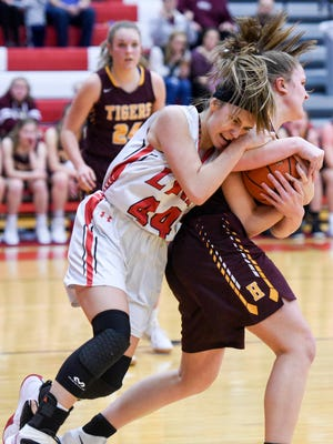Brandon Valley guard Trinity Law (44) fights for a rebound  during their high school basketball game on Jan. 30, 2018 at Brandon Valley High School. Harrisburg beat Brandon Valley 56-53.