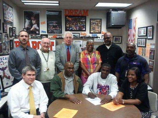 William Penn senior Tavon Parker signed his letter of intent Wednesday to play college basketball at Millersville University. Seated, from left: Principal Randy James, father Kelvin Parker Sr., Tavon Parker, mother Solita Day. Standing, from left: Basketball coach Troy Sowers, athletic advisor John Moroney, athletic director Joe Chiodi, grandmother Yvette Smallwood, grandfather Doug Smallwood and step father Ken Day. (SUBMITTED -- TROY SOWERS)