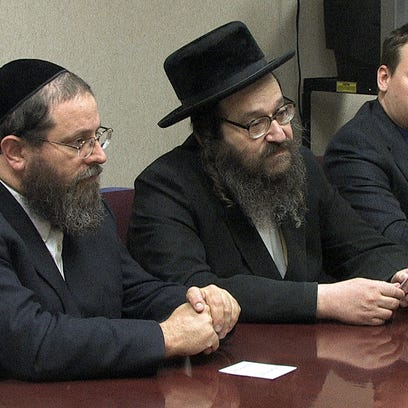 From left, Michael Tauber, Rabbi Mordecai Babad and
