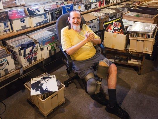 Matt Angerer poses for a portrait in the basement of