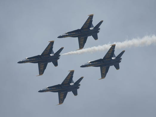 The U.S. Navy Flight Demonstration Squadron, the Blue Angels, take to the skies over Pensacola Naval Air Station during a practice session Wednesday March 26, 2014. An estimated crowd of more that 20,000 people watched the public practice from a viewing area behind the National Naval Aviation Museum.