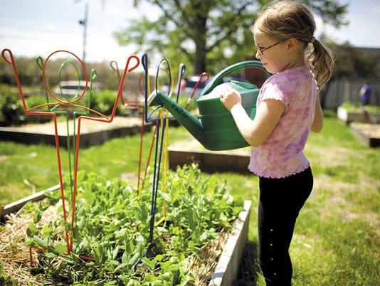 hes-sub-082915-child-gardening.jpg
