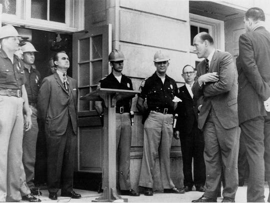 "Alabama Gov. George Wallace is shown making his ""stand in the schoolhouse door"" on June 11, 1963. He stood in the doorway at the University of Alabama to prevent two black students, Vivian Malone Jones and James Hood, from registering. Standing second from right is U.S. Attorney General Nicholas Katzenbach. (AP Photo/Tuscaloosa News, Calvin Hannah) MANDATORY CREDIT"