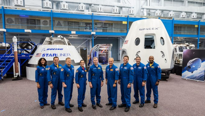 NASA on Friday, Aug. 3, 2018, introduced the first U.S. astronauts who will fly on American-made commercial spacecraft to and from the International Space Station -- an endeavor that will return astronaut launches to U.S. soil for the first time since the space shuttle's retirement in 2011. The agency assigned nine astronauts to crew the first test flight and mission of both Boeing's CST-100 Starliner and SpaceX's Crew Dragon. The astronauts are, from left to right: Sunita Williams, Josh Cassada, Eric Boe, Nicole Mann, Christopher Ferguson, Douglas Hurley, Robert Behnken, Michael Hopkins and Victor Glover.