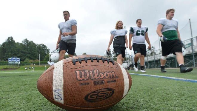 Following a morning practice, Mercyhurst University football players leave Tullio Field in 2018. PSAC schools will face many challenges as they prepare to possibly shift traditional fall sports to the spring.