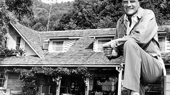 On the road for most of his long career, Graham headed back to North Carolina and his simple mountain home to restore his spirits. Here he is seen in 1975 at his home in Montreat.