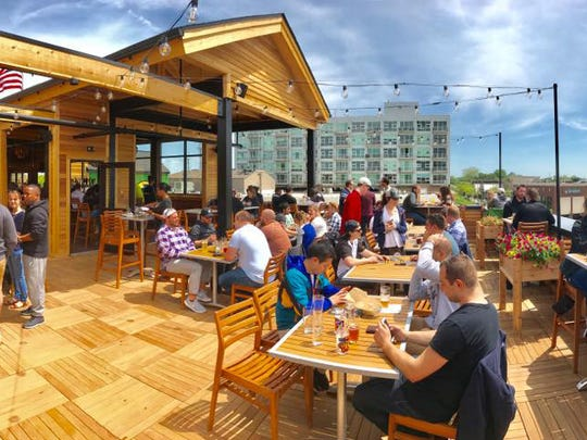 The owner of Michigan's HopCat locations disclosed during the hearing he was in default at several of his restaurant locations and had been evicted from his Royal Oak location, pictured here, following a 100% decline in profits.