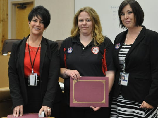 Skylar Calicoat, center, was given a six-year service award  as well as named Public Safety Supervisor of the Year.