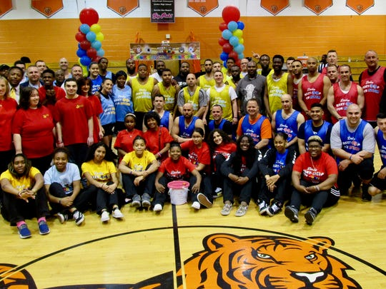 Teams from the Linden Police, Linden Fire, Linden Public Schools, and Linden Department of Public Property and Community Services gather with members of the Linden High School girls basketball team and the Union County Spectrum All-Stars at the Alley-Oop for Autism at the Linden High School gym on April 26.