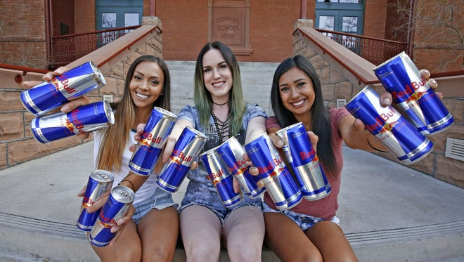 Arizona State University seniors Emily Poes, Katie Knoepker and Caira Button were chosen to compete in the Red Bull Can You Make It contest this summer, where they must travel from Barcelona to Paris using only Red Bull as currency. Their Wing Women team poses on the ASU campus in Tempe on March 21, 2016.