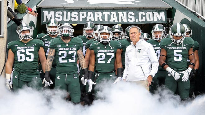 Nov 4, 2017; East Lansing, MI, USA; Michigan State Spartans head coach Mark Dantonio prepares to enter the stadium prior to a game against the Penn State Nittany Lions at Spartan Stadium.
