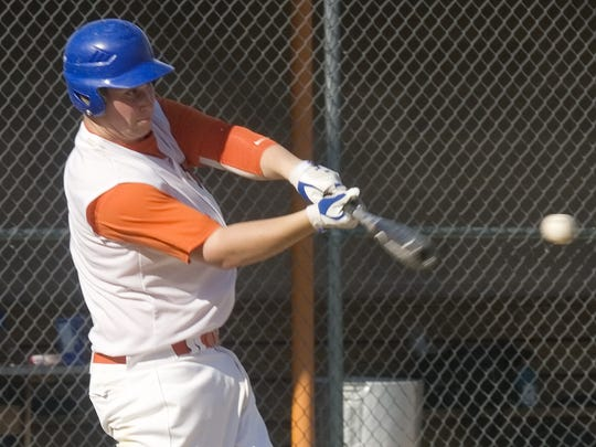Dylan Bellinger connects for a hit in 2011. Bellinger dropped 100 pounds after that season at Thomas A. Edison.