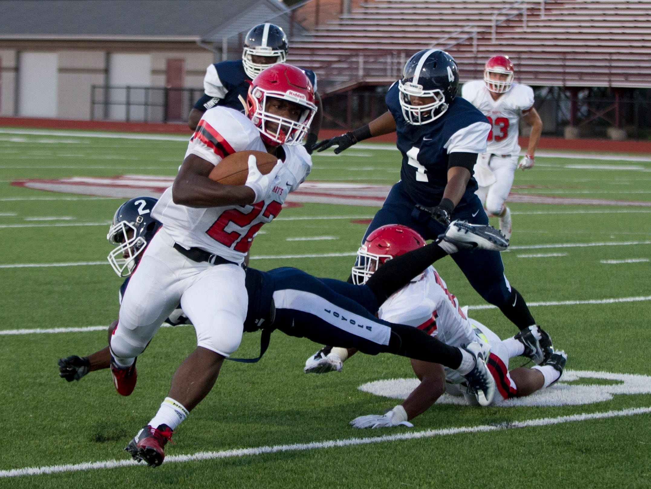 Orchard Lake St. Mary's running back RaShawn Allen dodges a tackle attempt from Detroit Loyola's Price Watkins during St. Mary's 35-14 win Friday at Hazel Park.