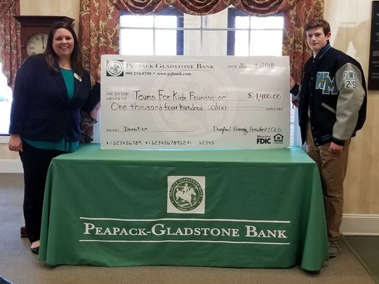 From left: Kate Sant'Angelo, Peapack-Gladstone Bank retail private banker, and Andrew Bauer, Teams for Kids Foundation.
