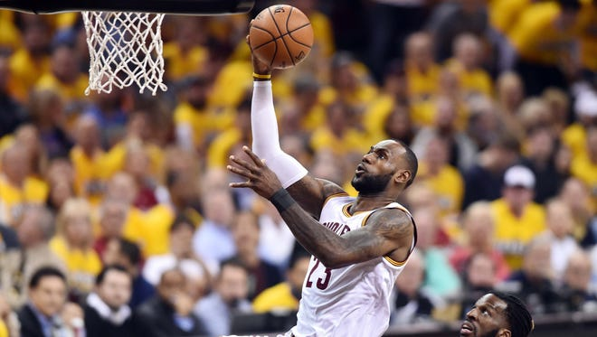 Cleveland Cavaliers forward LeBron James (23) drives to the basket against Toronto Raptors forward DeMarre Carroll (5) during the first quarter in game one of the second round of the 2017 NBA Playoffs at Quicken Loans Arena.