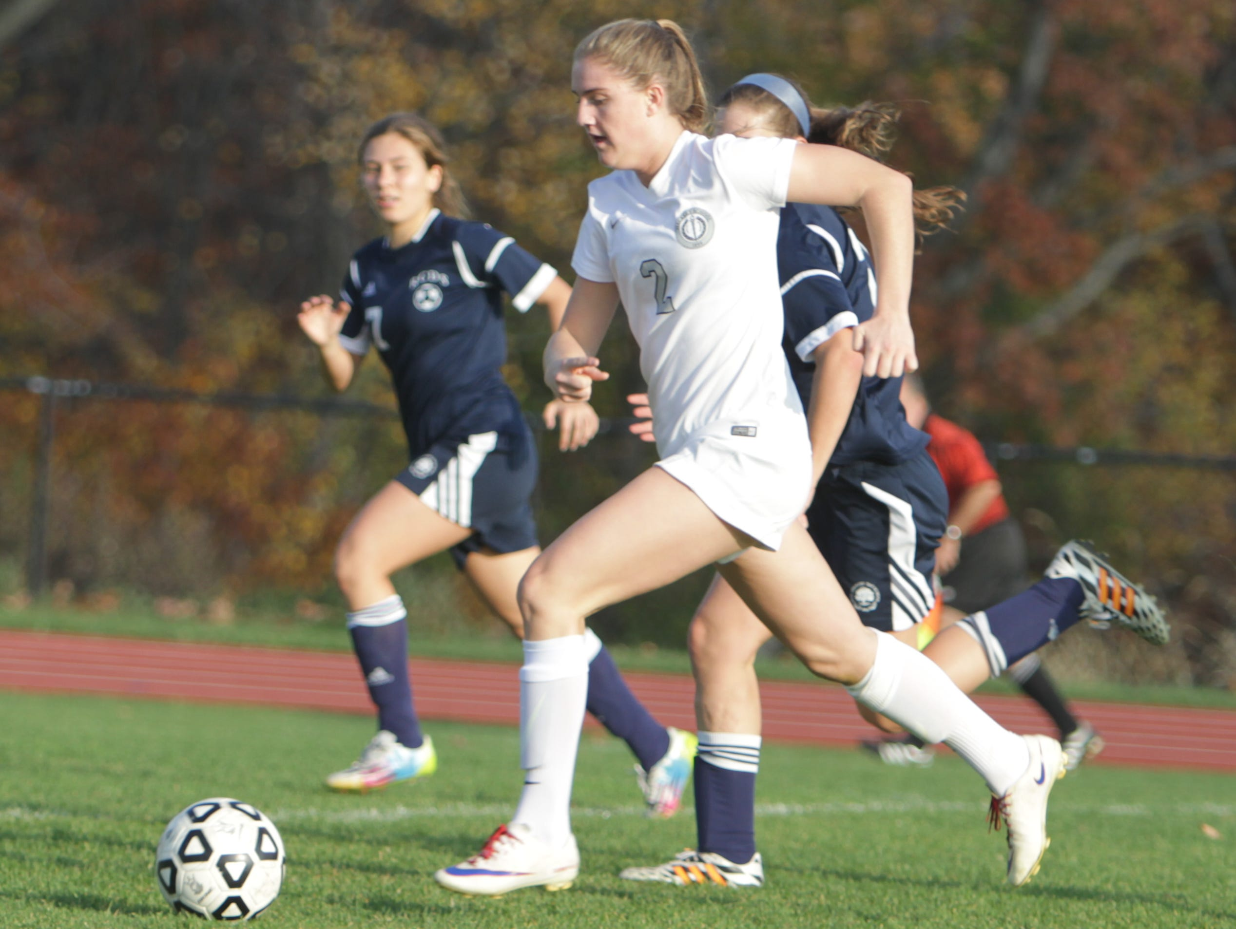 Hackley's Sammy Mueller dribbles the ball upfield during a NYSAIS semifinal match against Rye Country Day at the Hackley School on Friday, November 6th, 2015. Hackley won 3-1.