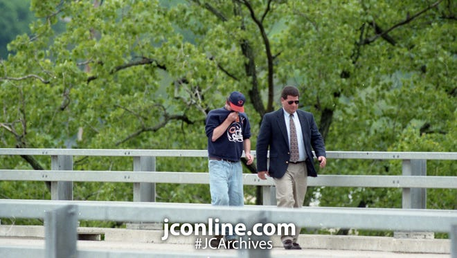 Lafayette Police Lt. Tony Roswarski, right, talks an unidentified man out of jumping off the eastbound span of the Indiana 26 bridge over the Wabash River. Photo taken May 24, 1995.