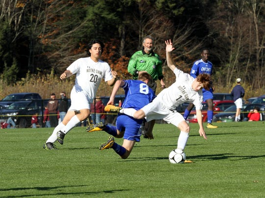 Oneonta's Eamon collides with Elmira Notre Dame's Gavin Harrington as Mitchell Vargas watches Saturday.