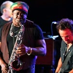 The late Clarence Clemons on the saxophone with Bruce Springsteen.