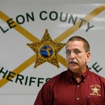 Sheriif Mike Wood jokes with his team in the violent crimes unit of the criminal investigations bureau at LCSO Friday Feb. 6, 2015.