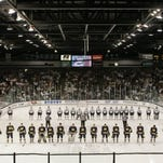New amenities, including theater lighting and a new center-ice scoreboard and ribbon boards around the 40-year-old venue, were installed this season to boost the fan experience inside Munn Arena.