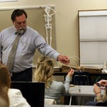 Tom Liston leads a class review Friday to prepare students for their final exam.