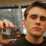 Some students struggle to find responsible ways to build credit. Here, Brad Vehafric, then 26, on the campus at  Portland State University, with his student credit card.