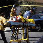 In this file photo, a victim is wheeled away by paramedics after a shooting in February 2008 in Salinas.