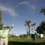 A volunteer keeps order at the La Quinta Country Club during the 2013 Humana Challenge golf tournament.