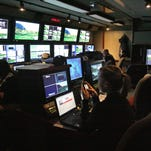 People work inside the graphics and scoring room inside an broadcasting truck at PGA West in La Quinta.