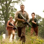 """Insurgent"" heroes Tris (Shailene Woodley), Four (Theo James) and Caleb (Ansel Elgort) run for their lives. A lot."
