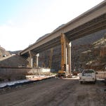 Crews work last week on the reconstruction of a bridge along Interstate 15 in the Virgin River Gorge. The project could create traffic delays over Labor Day weekend, and traffic managers are advising motorists to plan ahead.