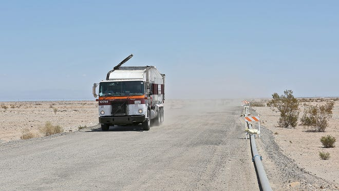A Burrtec garbage truck makes its way toward the Salton City solid waste site just outside of Salton City, Friday, August 15, 2014.