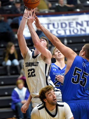 LVC's Andy Orr (22) and Will Boccanfuso battle in the paint against F&M's Lior Levy (55) during F&M's 73-67 win on Sunday in Annville.