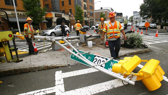 Crews from the NJ Department of Transportation were at the scene repairing a traffic signal knocked down on Sunday morning by a vehicular collision on a pedestrian island at the Morristown Green. September 17, 2017, Morristown, NJ