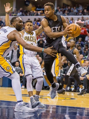 Brooklyn Nets guard Yogi Ferrell passes the ball while Indiana Pacers center Al Jefferson defends in the second half of the game on Friday night.