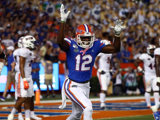 Sep 7, 2019; Gainesville, FL, USA; Florida Gators wide receiver Van Jefferson (12) celebrates as he scores a touchdown during the second quarter at Ben Hill Griffin Stadium. Mandatory Credit: Kim Klement-USA TODAY Sports