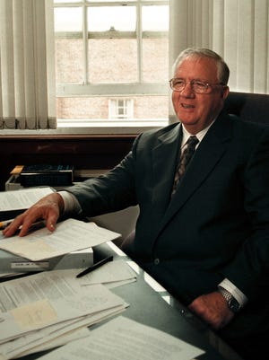 Harold 'Hal' Lane sits in his Statehouse office in Boston on July 13, 1999, discussing his upcoming retirement.