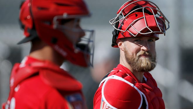 Cincinnati Reds catcher Tucker Barnhart (16) waits for his shift behind the plate during practice at the Cincinnati Reds training complex in Goodyear, Ariz., on Wednesday, Feb. 21, 2018.