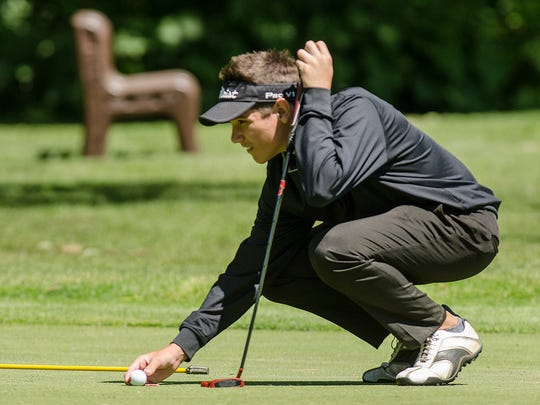 A key performer all season for regional champion Plymouth is freshman Ian Smith, shown measuring up a putt Wednesday at Pine View Golf Course.