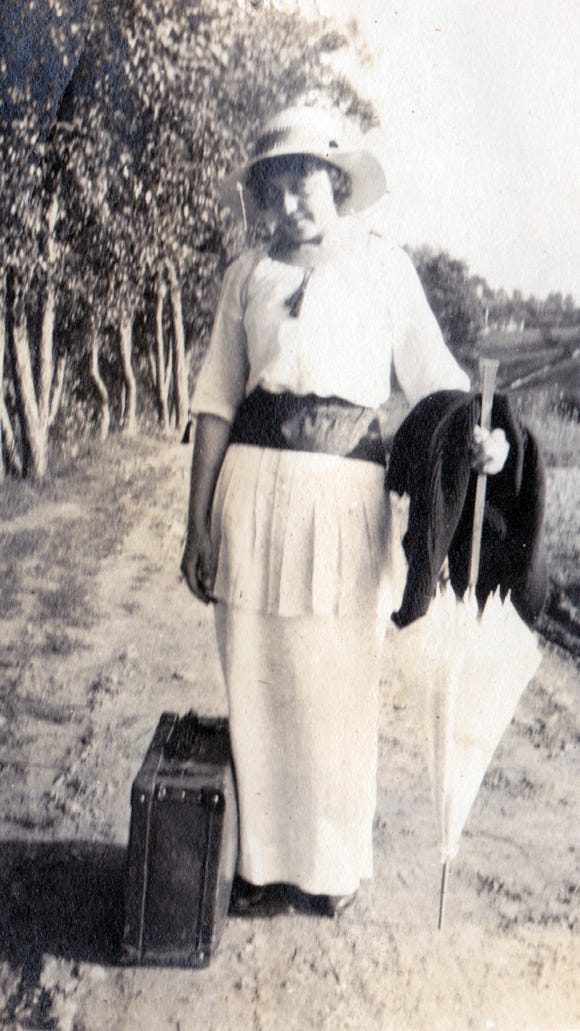 Joan (Posey) Edsell shared this photo of one of her mother's friends arriving for a week at Dick's Dam in Adams County, suitcase in tow. The photo has Aug. 1914 written on it.