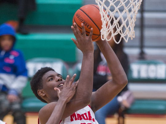 Manual's Jalen Johnson (32) puts up a shot during the